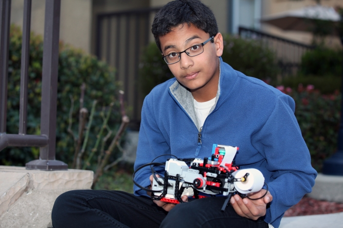 Shubham Banerjee and his braille printer. Photo courtesy of Niloy Banerjee.